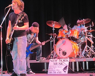 Battle of the Band winners Sinful Faith puts on a show for fans and spectators in the Boardman Performing Arts Center. Nick Deemer (left), Aaron Mannion (center) and Dylan Reid are all students of Boardman High School.