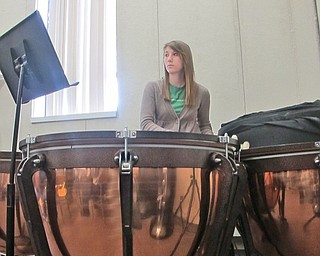 Senior Lauren DiCola focuses on her sheet music as she pounds away on the timpani drums.