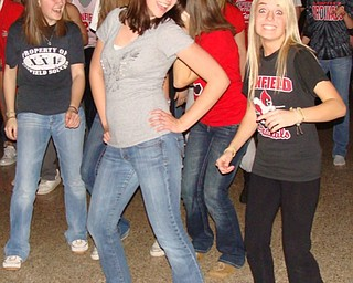 Kristin Pettola (left) and Taylor Dorman didn't shy away from the camera as they show off a few dance moves at the Canfield High School Sock Hop Jan. 18.