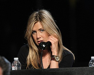 """In this image released by Hope for Haiti Now, Jennifer Aniston works the phone bank at the """"Hope for Haiti Now: A Global Benefit for Earthquake Relief"""", on Friday, Jan. 22, 2010 in Los Angeles. (AP Photo/Mark Davis/Hope for Haiti Now)"""