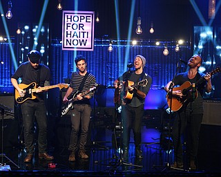 """In this image released by Hope for Haiti Now, Coldplay performs at the """"Hope for Haiti Now: A Global Benefit for Earthquake Relief"""", Friday, Jan. 22, 2010 in London. (AP Photo/MJ Kim/Hope For Haiti Now)"""
