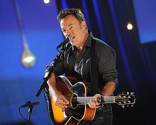 """In this image released by Hope for Haiti Now, Bruce Springsteen performs at """"Hope for Haiti Now: A Global Benefit for Earthquake Relief"""", on Friday, Jan. 22, 2010, in New York. (AP Photo/Evan Agostini/Hope for Haiti Now)"""