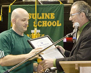 Coach P.J. Fecko and his football team at Mooney High School and Coach Dan Reardon with his team at Ursuline High School were honored at Covelli Centre by officials representing the City of Youngstown and the State of Ohio for bringing State Championship trophies home to the valley.