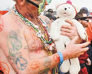 COLORFUL TRIBUTE: Ken Merwin of Bazetta sported 1960s memorabilia for Saturday's plunge.