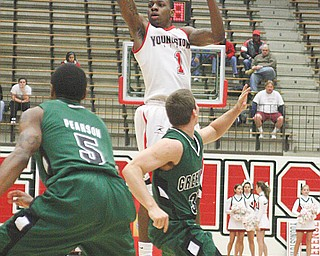 PENGUINS GO COLD: Youngstown State's DeAndre Mays (1) launches a pass over Green Bay Phoenix defenders during Sunday's game at YSU's Beeghly Center.  After playing a solid first half, the Penguins' offense went cold, and YSU dropped its fourth-straight game, 69-55.