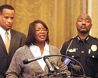 PLEA FOR HELP: Youngstown Councilwoman Janet Tarpley, D-6th, announces a $10,000 reward through the city's Crimestoppers program for information leading to the arrest and conviction of the person who shot and killed Angeline Fimognari, 80, on Saturday after attending Mass at St. Dominic's Church on East Lucius Avenue. Behind her is Mayor Jay Williams, left, and police Chief Jimmy Hughes.