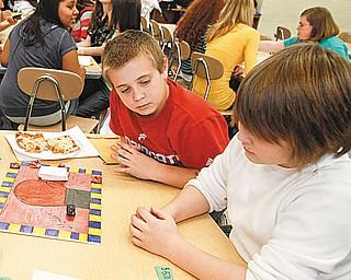 "The Vindicator/Lisa-Ann Ishihara ---Boardman Glenwood Middle School students L-R Chris Dailey (11) Matt Perham (11) Evan Noll (12) and Nick Patoray (11)  play the game "" Golden Gloves"" Wednesday afterschool ."
