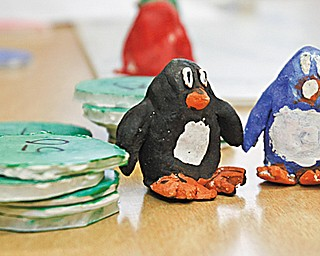 """The Vindicator/Lisa-Ann Ishihara ---Boardman Glenwood Middle School students created board games in their art class and got the opportunity to play them afterschool with classmates in the cafeteria. Pictured here  are game pieces from """"Penguinopoly"""""""