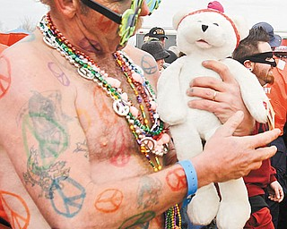 The Vindicator/Lisa-Ann Ishihara --.Ken Merwin of Bazetta dressed up to take the plunge into Mosquito Lake for the FreezinÕ for a Reason Polar Bear Plunge to benefit Special Olympics Ohio.