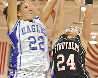 Struthers' Ashley Baron (24) and Hubbard's Haley Turner (22) during the first period Monday.