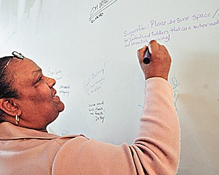 Orenda Johnson of the Hine Foundation leaves her mark (and idea) on the drywall at the new OH WOW.