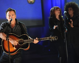 """In this image released by Hope for Haiti Now, Bruce Springsteen performs on """"Hope for Haiti Now: A Global Benefit for Earthquake Relief"""", on Friday, Jan. 22, 2010, in New York. (AP Photo/Evan Agostini/Hope for Haiti Now)"""