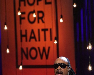 """In this image released by Hope for Haiti Now, Stevie Wonder performs at the """"Hope for Haiti Now: A Global Benefit for Earthquake Relief"""", on Friday, Jan. 22, 2010 in Los Angeles. (AP Photo/Mark Davis/Hope for Haiti Now)"""