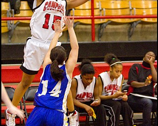 The Vindicator/Geoffrey Hauschild.Campbell's Jayaira Moses (15) Champion's Dana Thompson (14) during the third quarter of a game at Campbell High School on Wednesday evening.