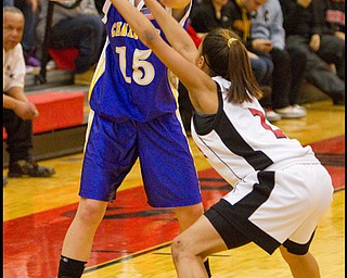 The Vindicator/Geoffrey Hauschild.Champion's Paige Loychik (15) Campbell's Tashira Uccta (1) during the second half of a game at Campbell High School on Wednesday evening.