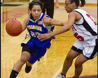 The Vindicator/Geoffrey Hauschild.Champion's Briana Lewis (22) Campbell's Jayaira Moses (15) during the second half of a game at Campbell High School on Wednesday evening.