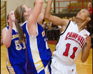 The Vindicator/Geoffrey Hauschild.Champion's Lindsay Swipas (10) Campbell's Brande Ellington (11) during the fourth quarter of a game at Campbell High School on Wednesday evening.