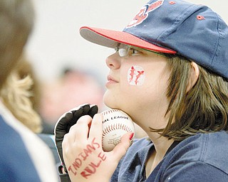 TRIBE DIEHARD: Sarah Welsh holds a baseball during a visit by three Indians players to Akron Children's Hospital on Market Street in Boardman on Tuesday. She was among the 100 Indians fans who listened to pitchers Aaron Laffey, David Huff and Chris Perez speak on the team's chances for 2010.