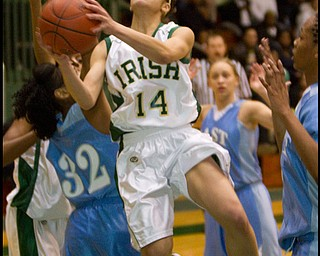 The Vindicator/Geoffrey Hauschild.Ursuline's Ja'Niece Whitehead (14) takes a shot during the second quarter of a game at Ursuline High School on Thursday evening.