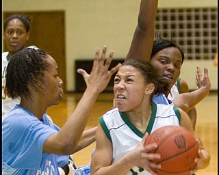 The Vindicator/Geoffrey Hauschild.Ursuline's Aurielle Irizzary (5) takes a shot only to be fouled while defended by East's Briana Dawson (10) and Lesa Monet Oliver (22) and during the second quarter of a game at Ursuline High School on Thursday evening.