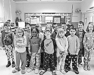 ST. PATRICK SCHOOL FUNDRAISER Special to The Vindicator NIGHT INTO DAY EVENT: Youngsters at St. Patrick School in Hubbard recently participated in a pajama dress-down event to raise funds to benefit the relief efforts in Haiti. Each child donated $1 or more to have the privilege of wearing pajamas to school. Pupils in Mrs. Scott's first-grade class were happy to take part in the event and proudly show off their comfortable, colorful attire. The school will sponsor additional dress-down days to raise funds for the relief effort.