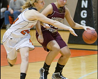 The Vindicator/Geoffrey Hauschild.Boardman's Monica Touvelle (32) shields the ball from Hoover's Lindsey Fiala (24) during the third quarter of a game at Hoover High School on Saturday afternoon.