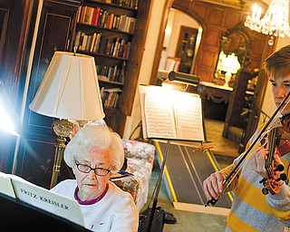 The Vindicator/Geoffrey Hauschild.Kathryn Walker plays piano as Pat Strasik, a junior at Boardman High School, prepares for an upcoming solo and ensemble during a music lesson at Glenellen Retirement Center on Friday afternoon. Strasik has been receiving lessons from Walker since seventh grade.