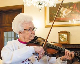 The Vindicator/Geoffrey Hauschild.Kathryn Walker plays the violin alongside Pat Strasik, a junior at Boardman High School, prepares for an upcoming solo and ensemble during a music lesson at Glenellen Retirement Center on Friday afternoon. Strasik has been receiving lessons from Walker since seventh grade.
