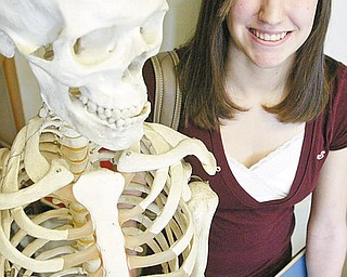 William D. Lewis/The Vindicator Girard HS 10 th grader Bryanna Jay poses for a portriat near a skeleton in hte school's biology room.