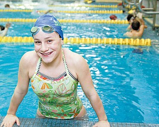 The Vindicator/Lisa-Ann Ishihara-- Gina Ungaro is a record-setting 10-year-old swimmer for the YMCA Y-Neptunes.