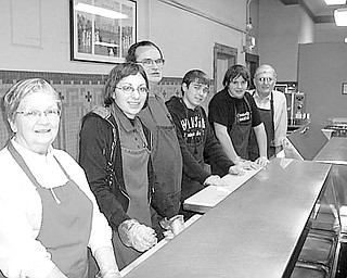 Special to The Vindicator SERVICE TO OTHERS: Continuing a tradition covering the past 10 years, members of the Rotary Club of Austintown have combined efforts with the Fitch Interact Club to serve dinners at the Rescue Mission on the fourth Monday of each month. Rotary provides ice cream each month as a contribution, and members enjoy the service aspect of the evening. From left to right are Judy Cebriak, Jessica Fercana, Ron Carroll, Brandon Rivello, Zarek Bell, and Tony Cebriak.