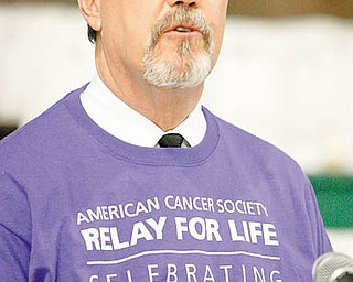 Tom Beasley  tells of his life experiences with cancer at St. Patrick School in Hubbard Relay for Life event.