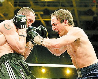 AFTERMATH: Billy Lyell, right, trades punches with Sebastian Sylvester of Germany during their IBF middleweight title fight in Neubrandeburg, Germany, on Saturday. Lyell said he was banged up and bummed out following the defeat, by TKO in the 10th round.