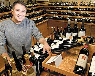 BEER RETAILER: Phill Reda, owner of Vintage Estate, poses with some of the more than 1,000 labels of wine in his beer and wine retailer operation. The company was named best beer retailer in the world by www.ratebeer.com.
