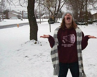Samantha Janis, 13, of Youngstown, tries to catch snowflakes.