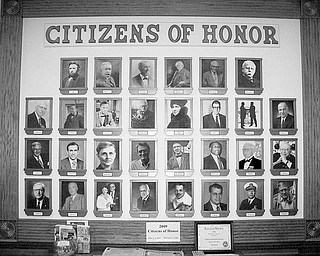 """Special to The Vindicator SALEM AWARD: Salem Historical Society is seeking nominations for its 2010 """"Citizens of Honor"""" award. In 2006, the inaugural class of 24 people were chosen during the Salem Bicentennial, and six more were added over the past three years. The criteria are for Salem-connected citizens, from the present or past, who have distinguished themselves with service to their community, their career and/or to their country. The selection of two citizens will be announced during the Founders Day program in April. Nominators should describe any field of accomplishment and involvement in the community. Send nominations by Feb. 12. to Salem Historical Society, 208 S. Broadway Ave., Salem, OH 44460, attention """"Citizens of Honor"""" committee. Above, the board displaying the Citizens of Honor is at the Salem Historical Society Museum."""