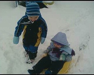 Henry and Sophia Detwiler, of Greensburg, Pa., go sledding. Their grandmother Donna Detwiler of North Lima.