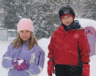 Jenna and Jared Benko of Boardman play in the snow.