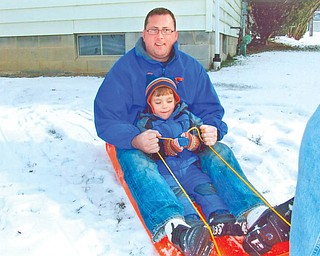 Oscar Wolf Calipari of Buffalo, N.Y., pictured with his uncle, Brian Wolf of Florida, was visiting his grandparents, Brian and Kathy Wolf of Liberty, over the Christmas holiday. The two guys had been tobogganing..