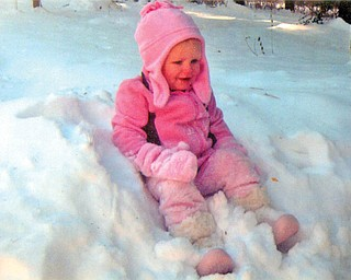 Reese Whitney Van Brocklin, 21 months, was visiting her grandparents, Harry and Jeanette Van Brocklin of Poland and Mark and Barbara Hall of Philadelphia, recently when she experienced snow for the first time. She is the daughter of Rob and Stephanie Van Brocklin of Odessa, Fla..