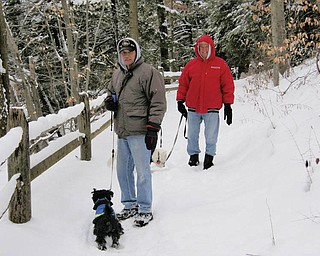 Jim Dorney and Frank Matthews of Youngstown were joined by their best friends, Scotty and Barney, for a winter walk in Mill Creek Park..
