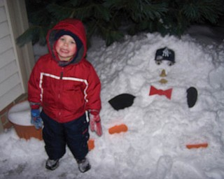 Aidan T. Radinsky of Canfield was playing in the yard with his daddy and his brother, Nolan P. Radinsky, they decided to build a ÒYankee ManÓ instead of a snowman..