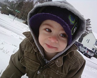 A.J. Holtzman, 16 months, son of Allen and Mindy Holtzman of Charlotte, N.C., formerly of Poland and North Lima, was playing in the snow for the first time. This was a real treat for A.J. because Charlotte rarely gets enough snow to actually play in it..