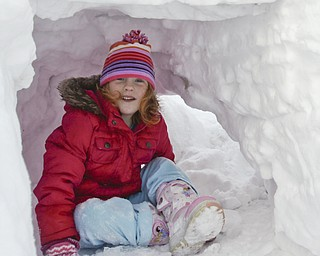 The Vindicator/Lisa-Ann Ishihara--- Emily Evans (5) of Austintown sits in the fort her father helped make.