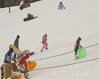 The Vindicator/Lisa-Ann Ishihara--- Residents have fun in the snow at Mill Creek Park's  Wick Recreation Area .