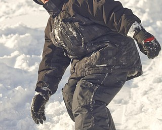 The Vindicator/Lisa-Ann Ishihara--- Dylan Ward (8) boards down the hill in the snow at Mill Creek Park's  Wick Recreation Area .