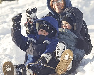 The Vindicator/Lisa-Ann Ishihara--- Melissa Ward of Liberty, and sons Evan (5) and Zach (3) slide down the hill in the snow at Mill Creek Park's  Wick Recreation Area .
