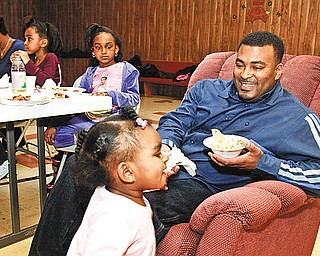 FAMILY AFFAIR: Youngstown 2nd Ward Councilman DeMaine Kitchen, right, enjoys Super Bowl 44 at a non-alcoholic, family-oriented party at Rising Star Baptist Church, with his family. From left are: Leslie, his wife, and their children, Savannah, 4, Olivia, 6, and Amber, 1.