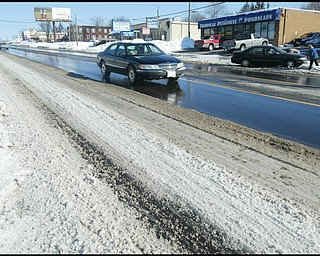 William D. Lewis /The vindicator  Market St in Boardman near Indianola Rd Monday morning. Snow  on street.