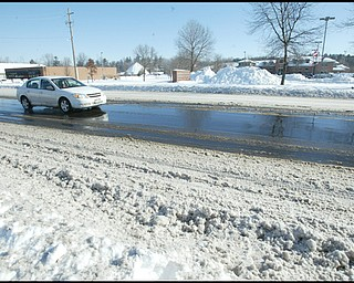 William D. Lewis /The vindicator  Market St in Boardman nearTownship Building Monday morning. Snow  on street.